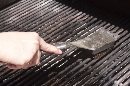 Cleaning a bbq grill Stock Photo