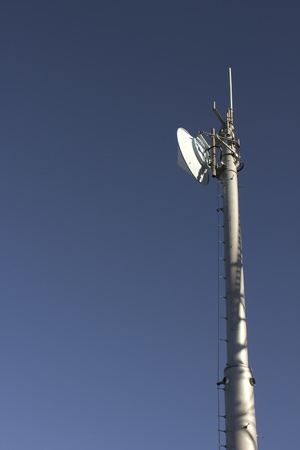 radio communications tower with a blue background photo