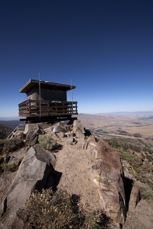 a beautiful fire lookout in the Tahoe National Forest with bright blue slies. Stok Fotoğraf