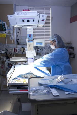 A NICU nurse in action.