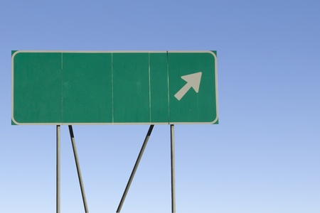 blank road sign: Green road sign with a blue sky gradient background.