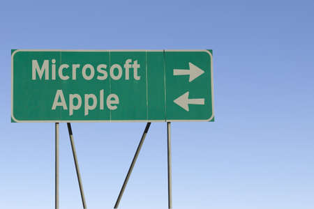 microsoft: Green road sign with a blue sky gradient background.