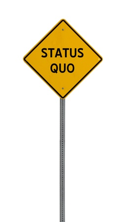quo: a yellow road sign with the words STATUS QUO on white background