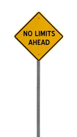 a yellow road sign with the words NO LIMITS AHEAD on white background
