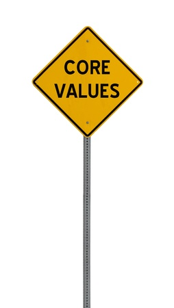 a yellow road sign with the words CORE VALUES on white background photo