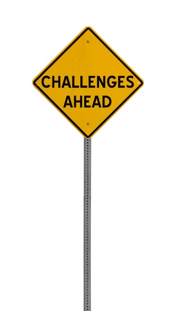 hard work ahead: a yellow road sign with the words CHALLENGES AHEAD on white background