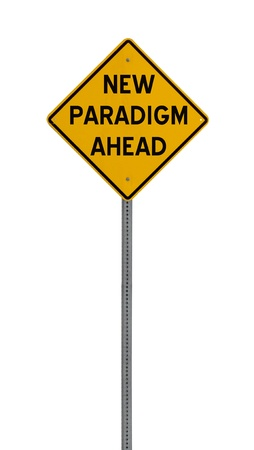 a yellow road sign with the words NEW PARADIGM AHEAD on white background Stock Photo