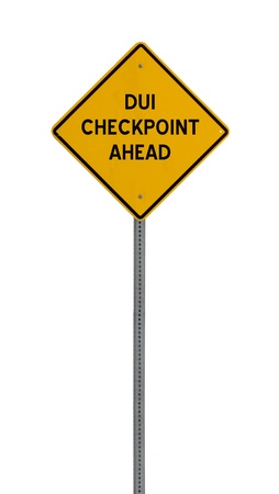 a yellow road sign with the words DUI CHECKPOINT AHEAD on white background 版權商用圖片