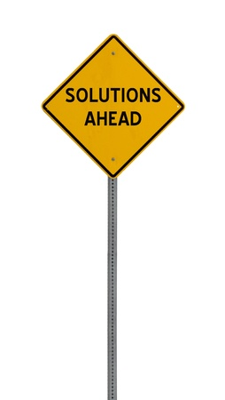 a yellow road sign with the words SOLUTIONS AHEAD on white background photo