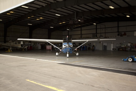 Small airplanes in the shop at an airport. Editorial
