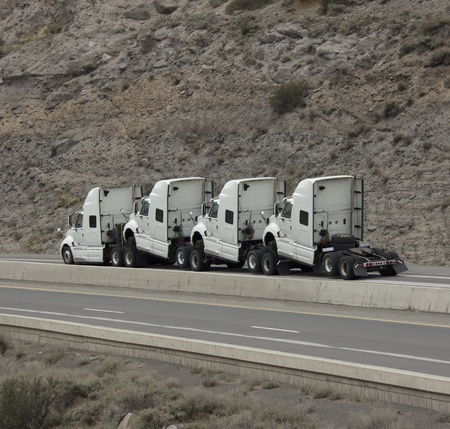 4 humped trucks towing