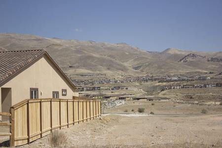 non: a new house with a non developed backyard