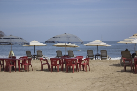 beach with chairs and umbrellas photo