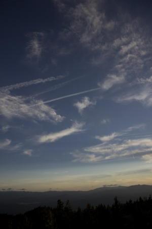 Clouds at dusk in the mountains. dark mountains and a bright blue sky. Stock Photo - 14050304