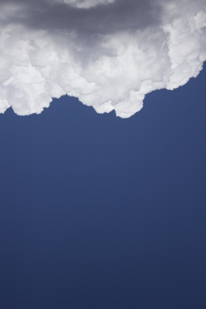 Dramatic Cloudy Sky with a deep blue background. photo
