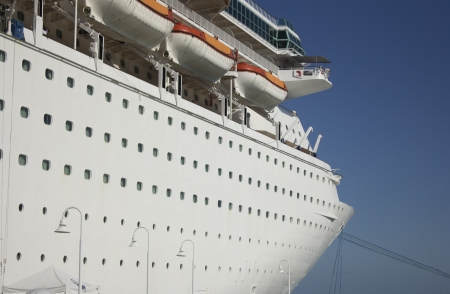 bowsprit: A very large cruise ship in a tropical location.