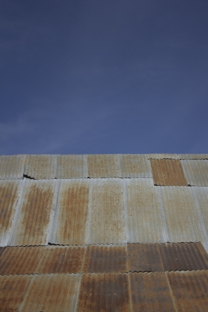 corrugated steel roofing with blue skies Reklamní fotografie