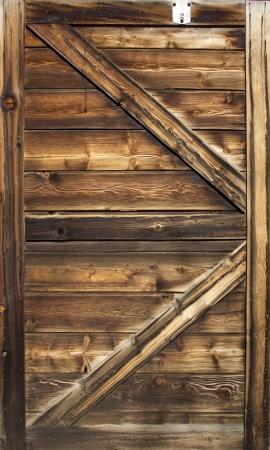 Old barn door wood textured with slanted braces