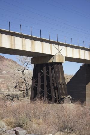 An old train bridge crossing teh truckee river in western nevada