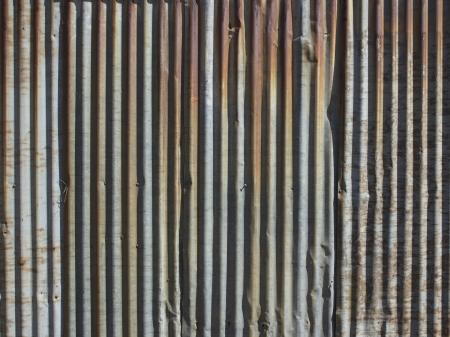 corrugated iron: A rusty corrugated iron metal fence close up Zinc wall