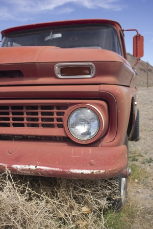 an old rusty pickup truck in the desert. Blue skies and tumbleweeds.  photo