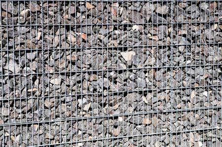 gabion: Gabion made of grey stone