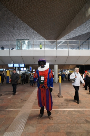 public transfer: Zwarte piet at train station Rotterdam
