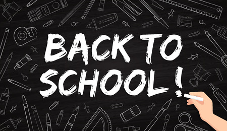 Back to school - office supplies drawn with chalk on a blackboard
