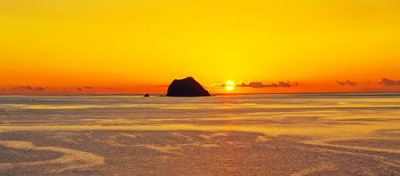 Sun rise from ocean photo