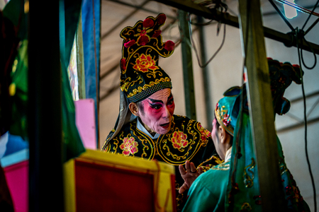 Chinese Teochew Opera. Performers at backstage getting ready to perform during Chinese Ghost Festival. Asian traditional cultural arts.