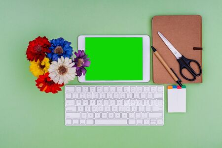 Green screen tablet, keyboard, office school stationery on green background. Flat lay top down view. Business Objects Technology concept. Stok Fotoğraf