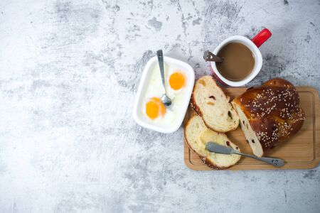 Flat lay, breakfast brunch on table. Coffee, soft-boiled eggs and butter spread. Food drink concept.