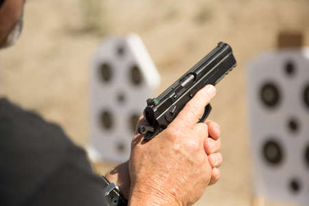 Man holding a pistol at the ready position