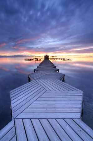 Jetty in zigzag and a beautiful sunrise photo