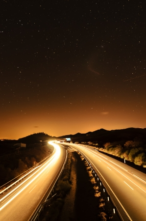 long exposure: traffic at night in a motorway under the stars