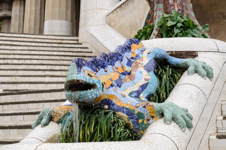 Ceramic dragon fountain in Parc Guell - park city designed by Antoni Gaudi  Spain photo