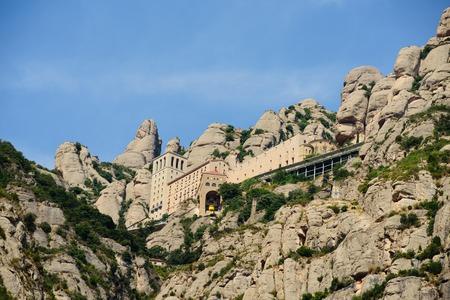 Santa Maria de Montserrat Abbey in Monistrol de Montserrat, Catalonia, Spain. Famous for the Virgin of Montserrat Stock Photo