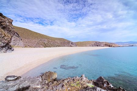Los Muertos beach Playa de los muertos in Cabo de Gata Nijar Natural Park, Almeria, Andalusia, Spain. Very popular spot with tourists. Most famous beach in the area. Close to Carboneras village.