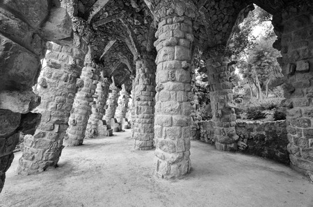 arcos de piedra: Barcelona: Amazing stone arches at Park Guell, the famous and beautiful park designed by Antoni Gaudi, one of the highlights of the city Foto de archivo