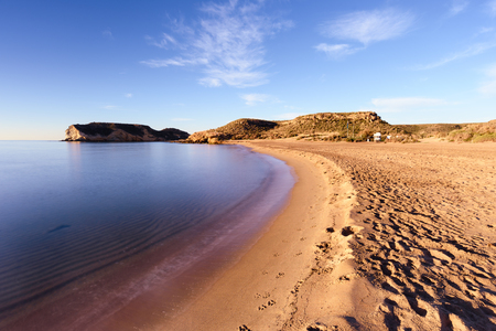 La Higuerica beach in Aguilas, Murcia. A strecht of golden sand flanked by vegetation and dunes. A blue flag beach Фото со стока