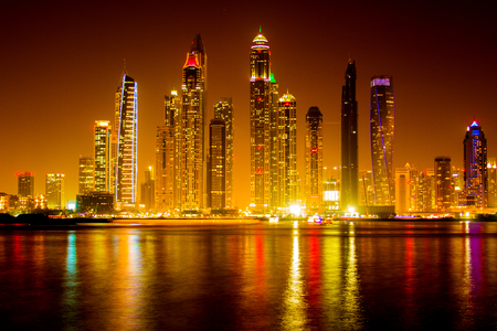 residential construction: Dubai - April 29, 2017: Dubai Marina skyscraper skyscrapers twilight night blue hour city UAE
