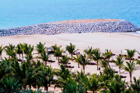 khaima: Al Hamra beach with rock wall & coconut trees, a view from Al Hamra Beach Resort March 01, 2017