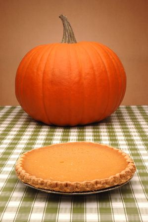 Pumpkin and Pie on Table Stock Photo