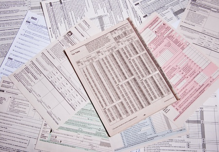 Multi colored and topics tax forms spread