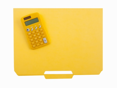 Yellow calculator and file folder photo