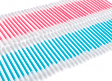 Pink and blue q-tips in rows on white