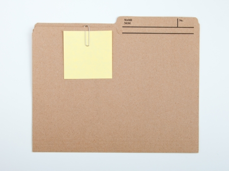 file clerk: Color note papers for reminder on folder Stock Photo