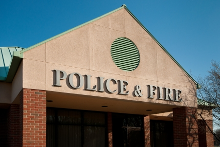 depts: Town municipal building housing police and fire depts Stock Photo