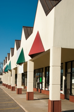 Building with row of various stores Stock Photo