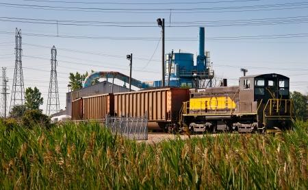 boxcar train: Coal train power plant unloading shed Stock Photo